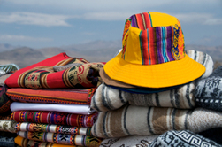 Alpaca Hat and Blankets displaying Andean colors